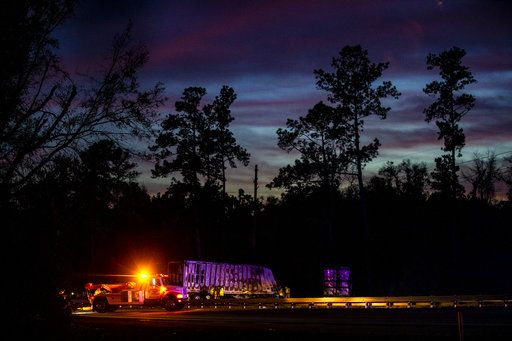 CORRECTS SOURCE TO THE GAINESVILLE SUN The sun sets over burned semi-trucks and vehicle debris after a wreck with multiple fatalities on Interstate 75, south of Alachua, near Gainesville, Fa., Thursday, Jan. 3, 2019. Two big rigs and two passenger vehicles collided and spilled diesel fuel across the Florida highway Thursday, sparking a massive fire that killed several people, authorities said. (Lauren Bacho/The Gainesville Sun via AP)