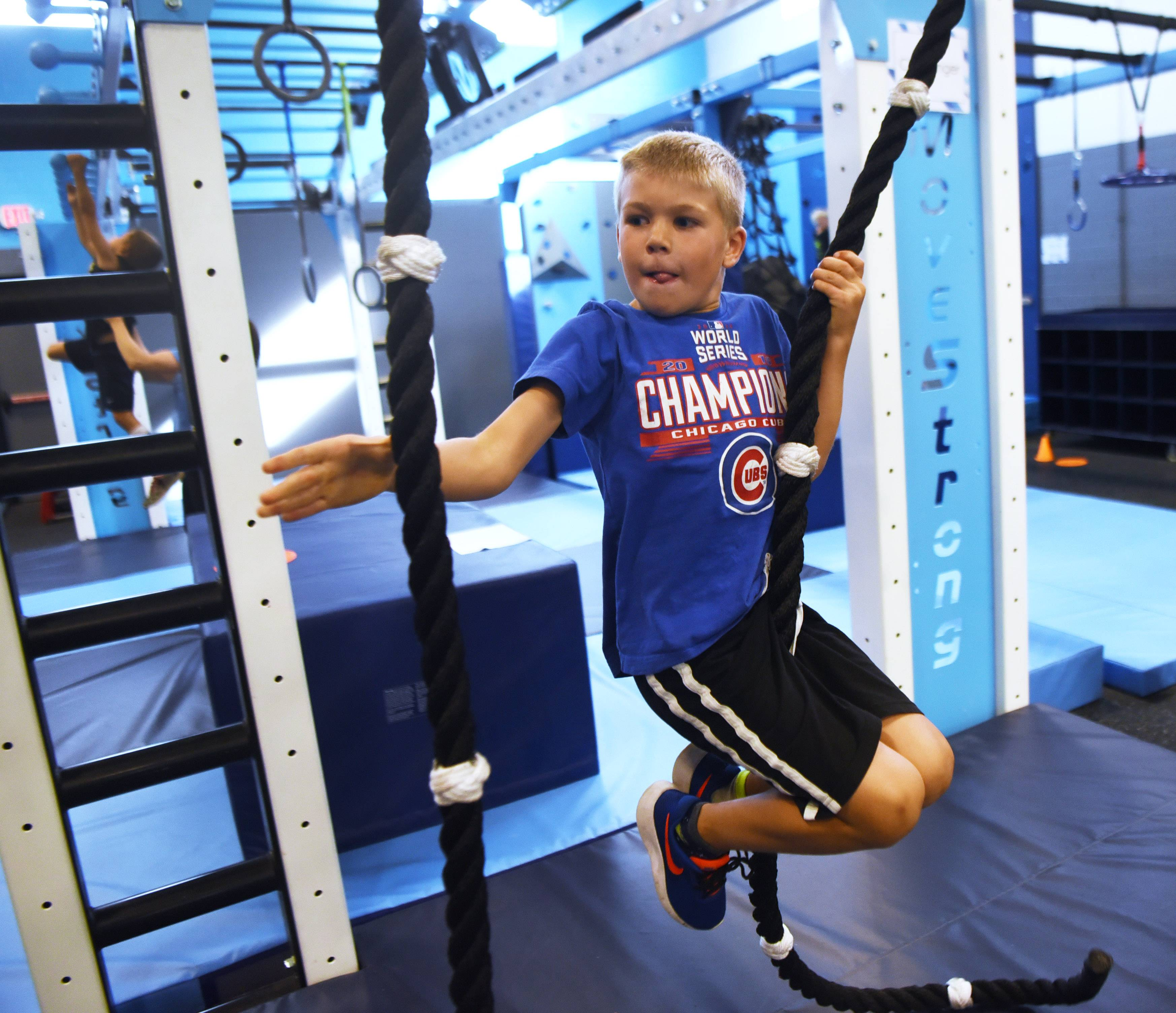 Duncan Phipps, 7, swings from rope-to-rope at Windy City Ninjas in Elmhurst. The 12,000-square-foot facility includes gym space, two party rooms and a viewing mezzanine for parents to watch their children.