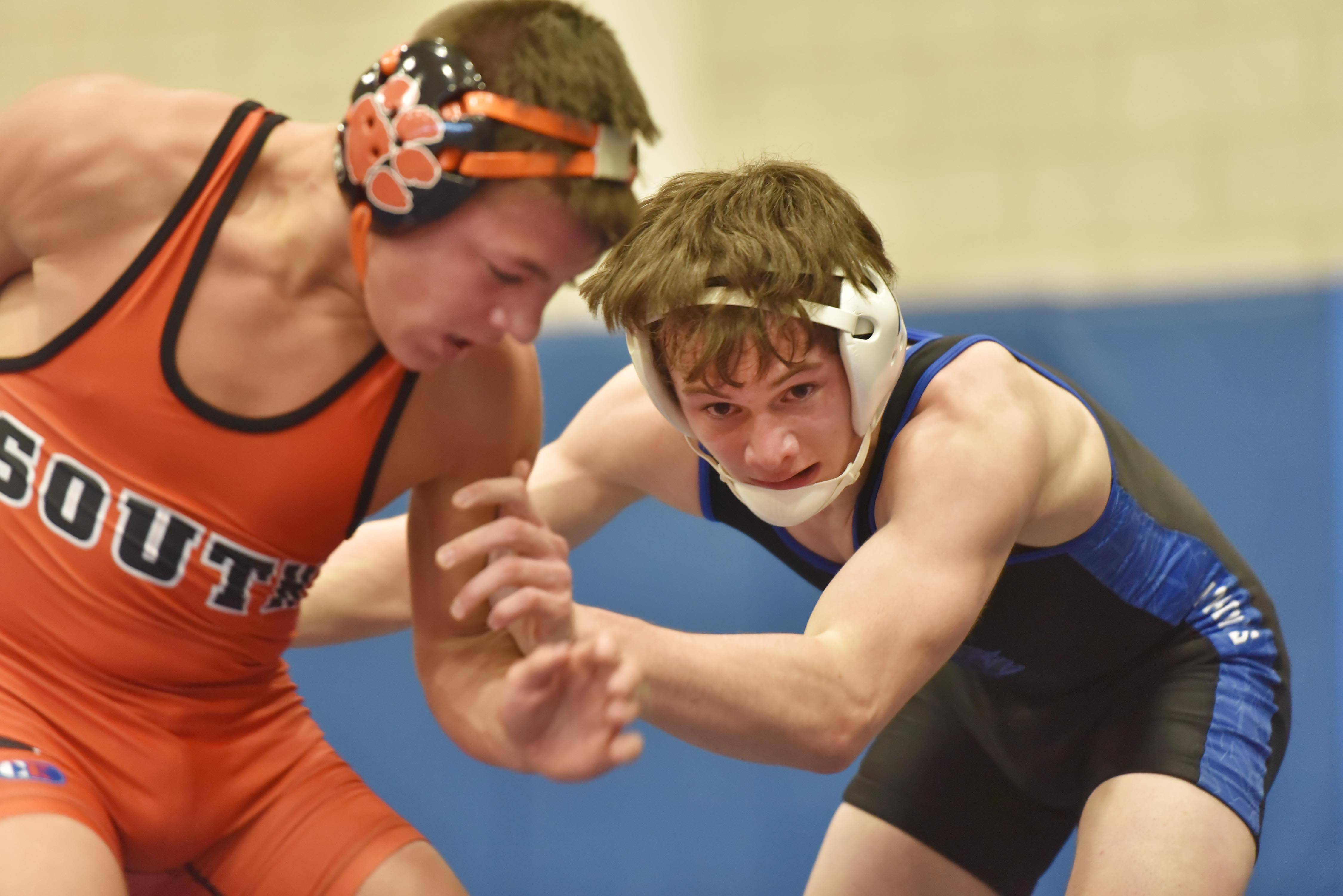 Geneva's Ian Puck chases Wheaton Warrenville South's Aidan Waszak in the 120-pound semifinal bout at the Jim Newbill wrestling invitational at Geneva High School Saturday.