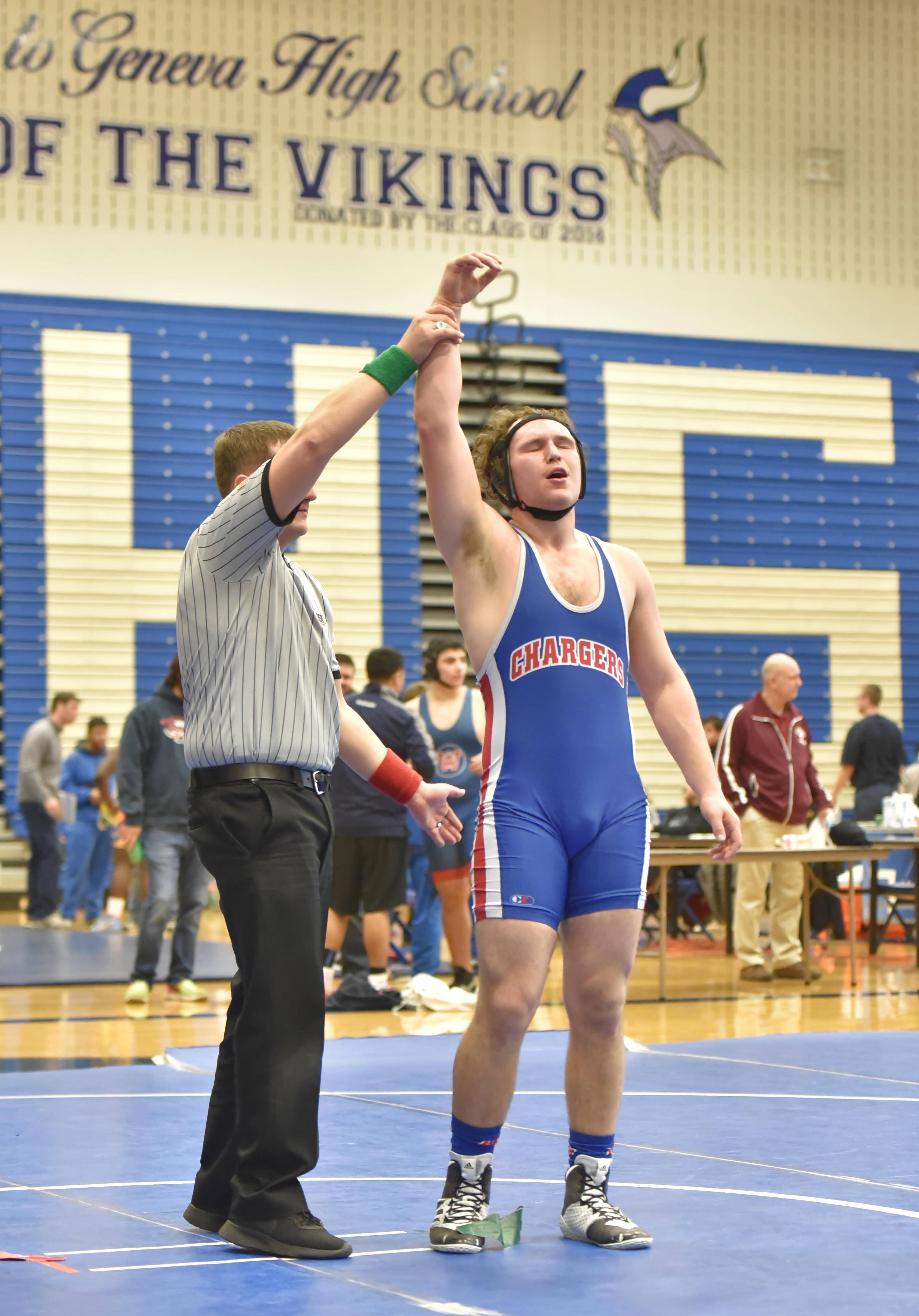 Dundee-Crown's Carter Fitch is declared the winner over Stillman Valley's Logan Jennings in their 195-pound bout.