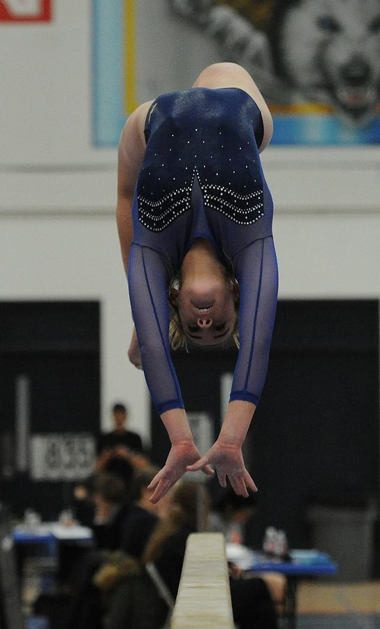 Neuqua Valley's Baylee Modaff masters the balance beam at the Naperville North girls gymnastics invite at Naperville North High School on Saturday.