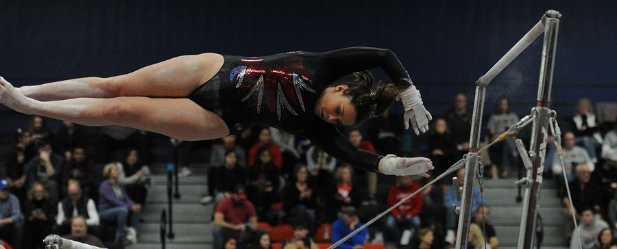Lexi Swanson of Naperville Central on the Uneven Parallel Bars at the Naperville North girls gymnastics invite at Naperville North High School on Saturday.