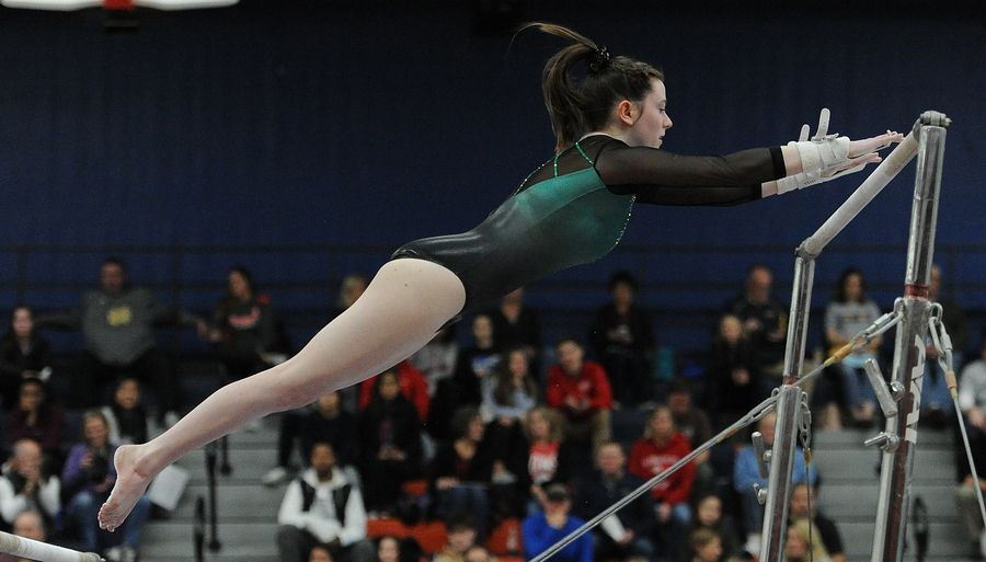 Sydney Hill of York on the Uneven Parallel Bars at the Naperville North girls gymnastics invite at Naperville North High School on Saturday.
