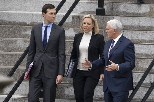 White House Senior Adviser Jared Kushner, left, Homeland Security Secretary Kirstjen Nielsen, and Vice President Mike Pence, talk as they walk down the steps of the Eisenhower Executive Office Building on the White House complex, Saturday, Jan. 5, 2019, in Washington.