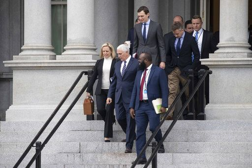 Homeland Security Secretary Kirstjen Nielsen, left, Vice President Mike Pence, White House legislative affairs aide Ja'Ron Smith, followed by White House Senior Adviser Jared Kushner, and others, walk down the steps of the Eisenhower Executive Office building, on the White House complex, after a meeting with staff members of House and Senate leadership, Saturday, Jan. 5, 2019, in Washington.