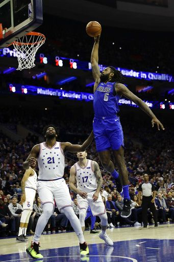 Dallas Mavericks' DeAndre Jordan (6) goes up for a dunk against Philadelphia 76ers' Joel Embiid (21) during the first half of an NBA basketball game, Saturday, Jan. 5, 2019, in Philadelphia.