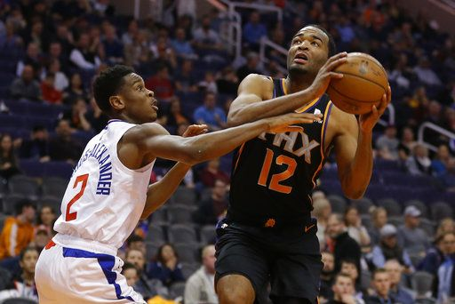 f23d4989573a Phoenix Suns forward T.J. Warren drives past Los Angeles Clippers guard  Shai Gilgeous-Alexander (