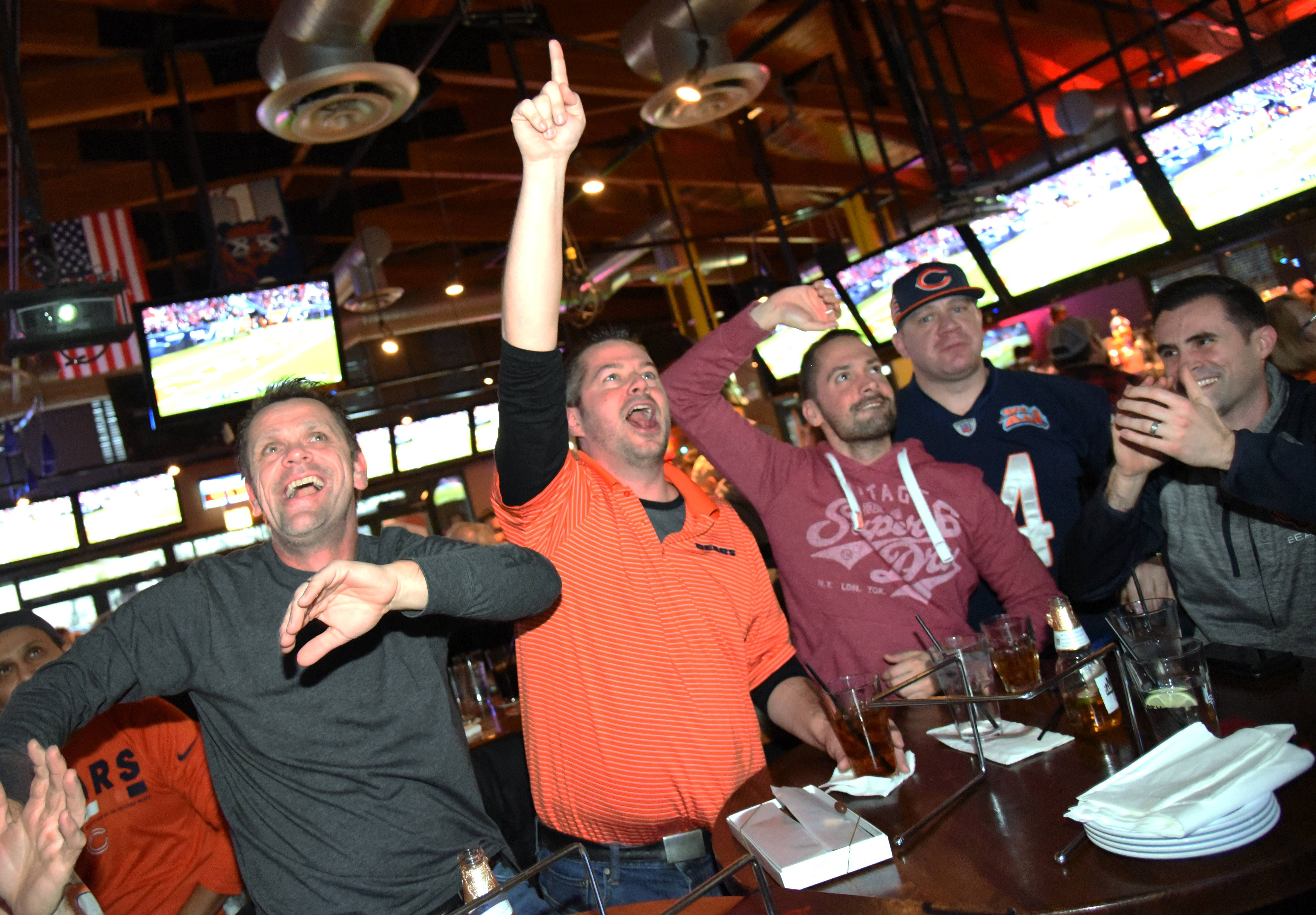 Chicago Bears fans from left Ken Topolski of Elgin, Joe Tomal of Elk Grove Village, Arthur Szczypta of Chicago, Al Wdowiak of Chicago and David Smreczak of Naperville react to a play early during Sunday's game against the Eagles while watching at Real Time Sports Bar in Elk Grove Village.