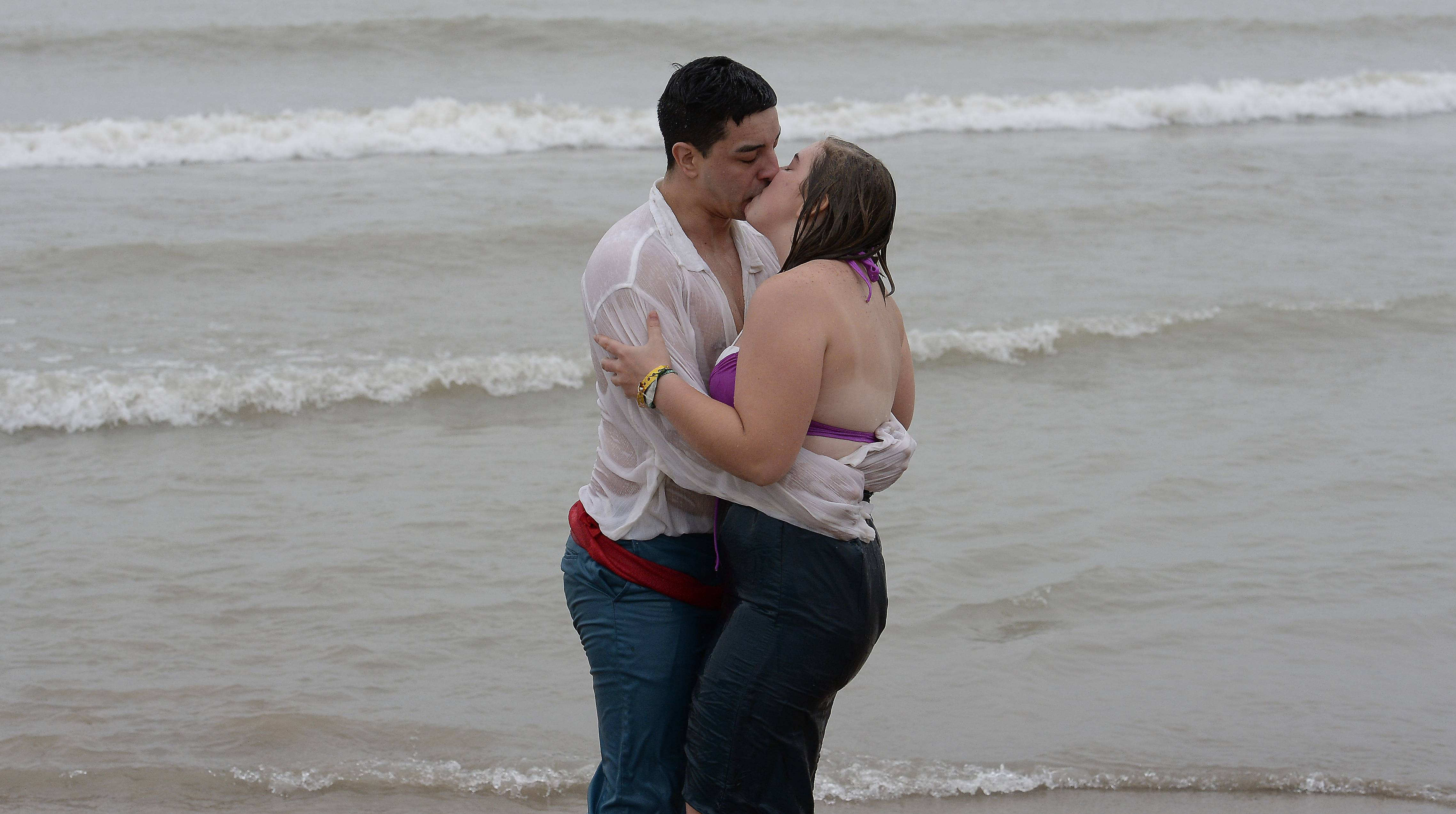"The 20th Annual Polar Bear Plunge challenge was met with over a hundred enthusiastic, brave souls like Eric Bonilla, of Waukegan and his girlfriend Lynsey Gallagher of Kenosha, Wisconsin who wanted to do good for the Waukegan Special Recreation Services. ""Getting in the water is not so bad, it's getting out,"" said Gallagher of her first plunge. Then Bonilla planted a big kiss on her after they braved the waves."