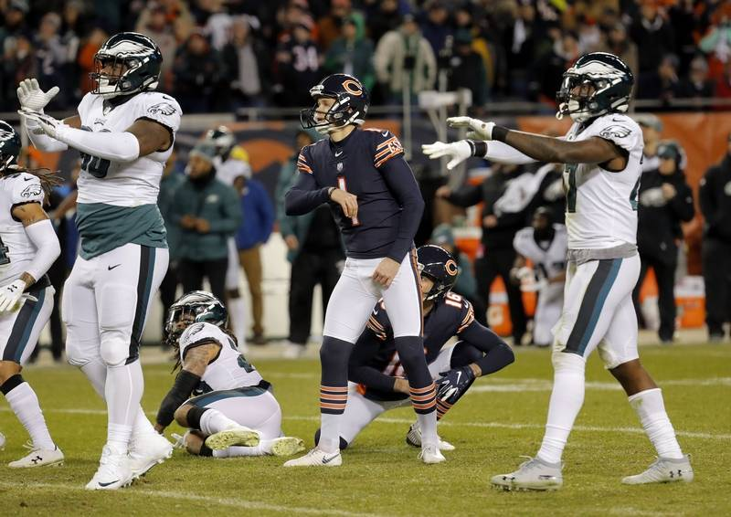 Eagles players signal no good as Chicago Bears kicker Cody Parkey looks on during the Bears loss to the Eagles 16-15 in the NFC wild card game Sunday, January 6, 2019 at Soldier Field in Chicago.