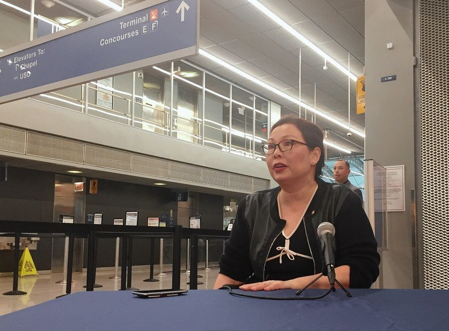U.S. Sen. Tammy Duckworth discusses the government shutdown Monday at O'Hare International Airport.