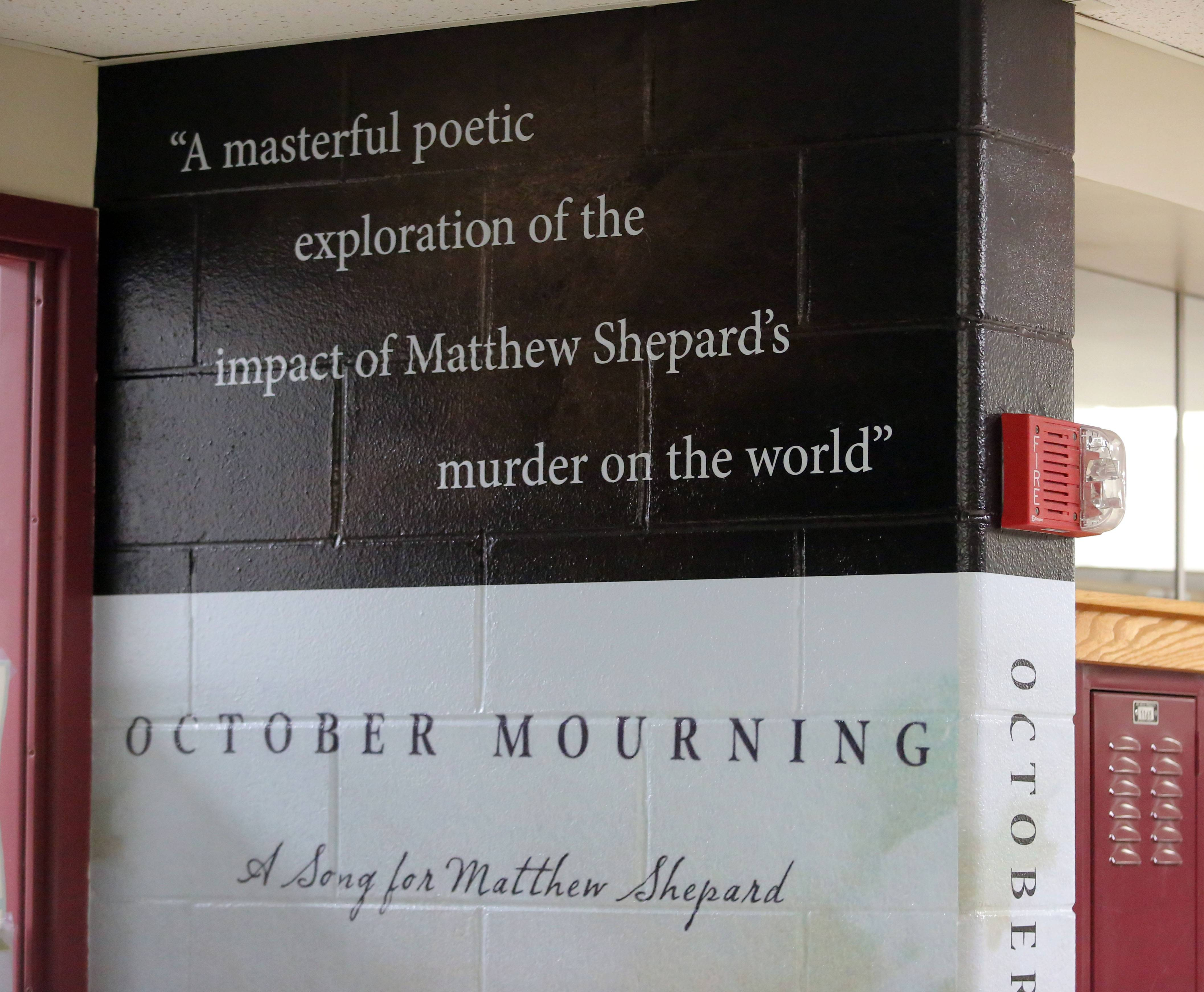"A mural depicting the cover of the book ""October Mourning"" adorns the wall outside English teacher Mike Dayton's classroom at Mundelein High School."