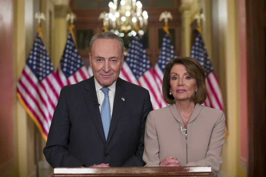 Senate Minority Leader Chuck Schumer of N.Y., and House Speaker Nancy Pelosi of Calif., speak on Capitol Hill in response President Donald Trump's address, Tuesday in Washington.