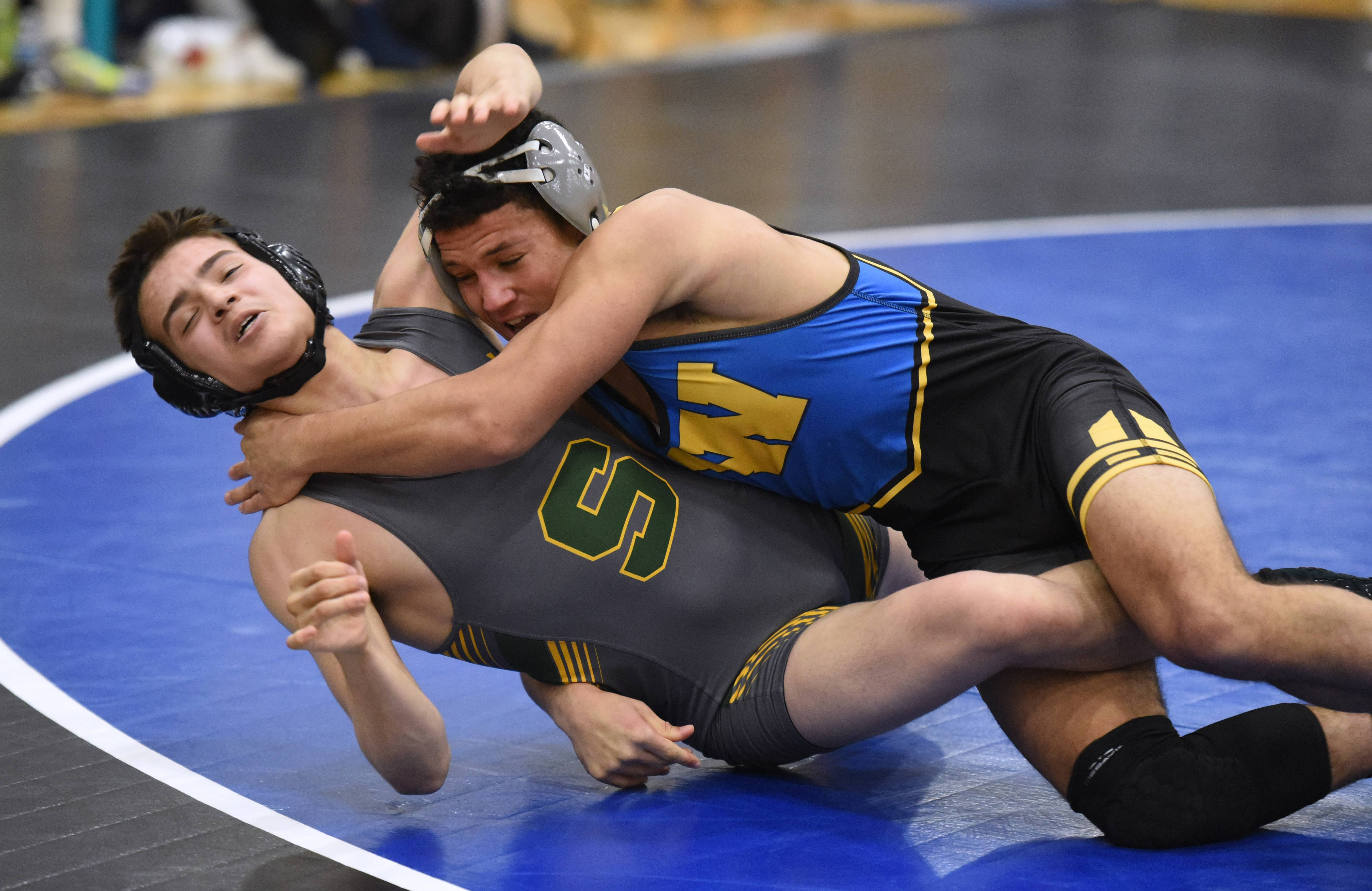 Warren's Isaiah Parker, right, takes down Stevenson's Jason Bickers during the 152-pound  wrestling match Thursday in Gurnee.