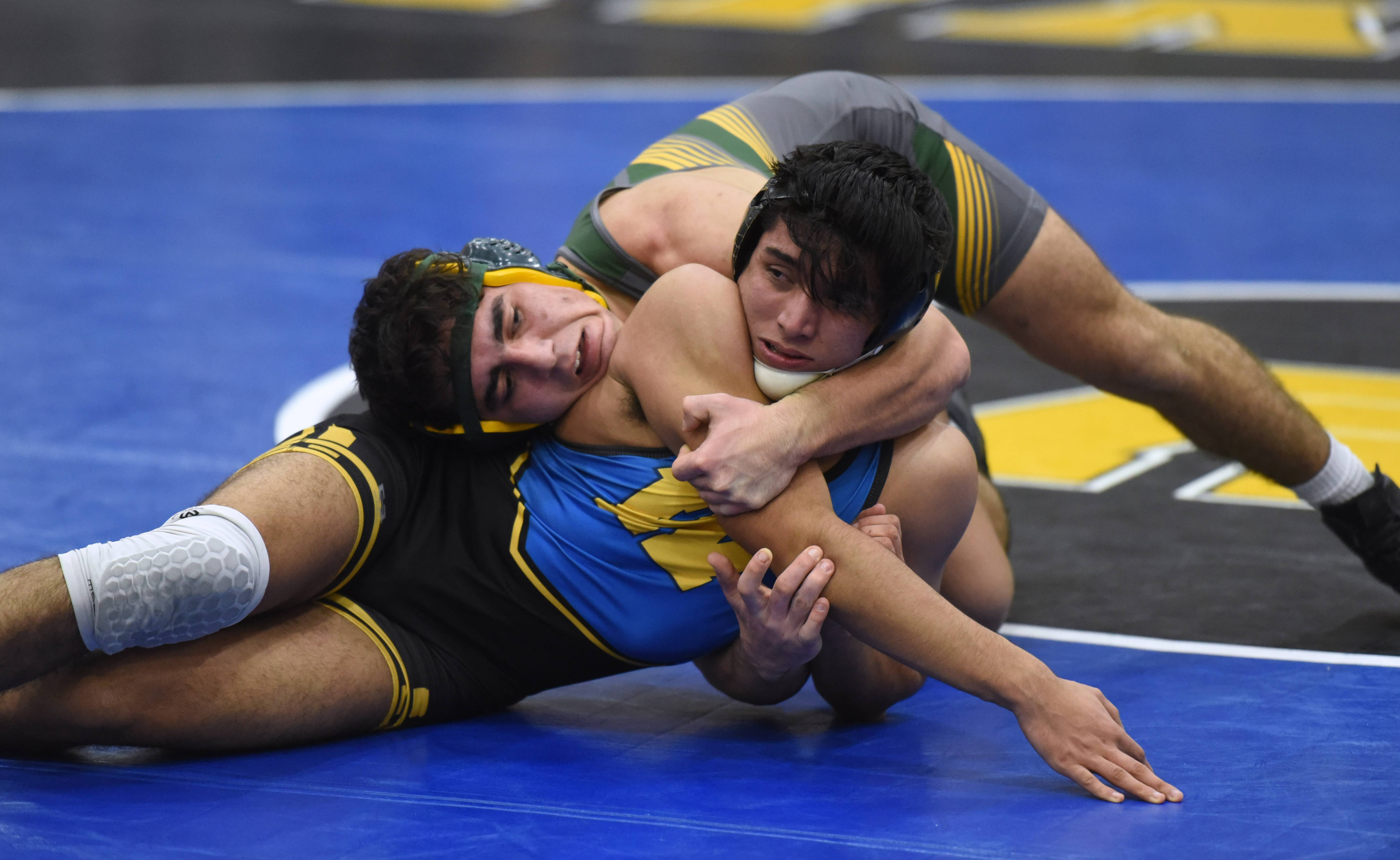 Stevenson's Ivor Gueorguiev, top, puts the squeeze on Warren's Edgar Maldonado during the 160-pound wrestling match Thursday in Gurnee.