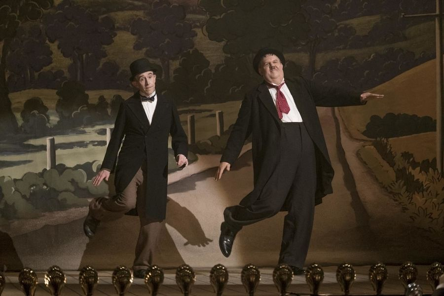 "Comedians Stan Laurel (Steve Coogan), left, and Oliver Hardy (John C. Reilly) embark on a final act -- years past their showbiz prime -- in ""Stan & Ollie."""
