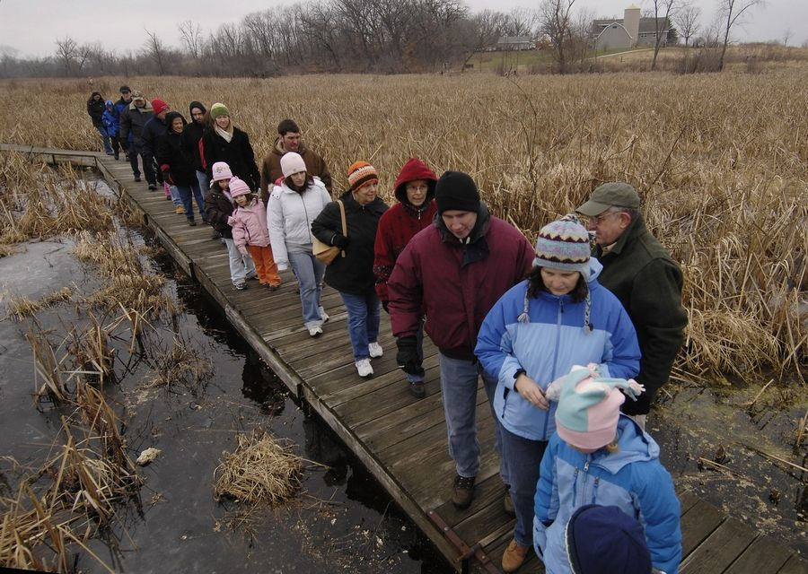 A tour heads into the bog along a floating trail during a previous festival at Volo Bog State Natural Area. This year's WinterFest takes place from noon to 4 p.m. Jan. 13.