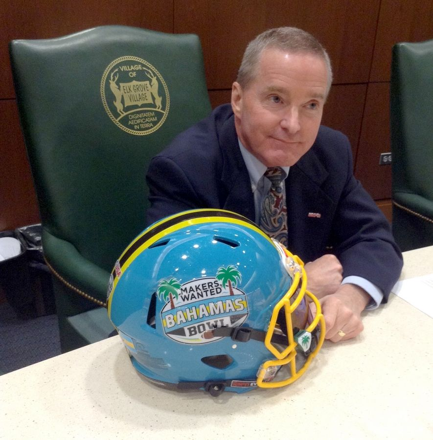 Elk Grove Village Mayor Craig Johnson brought a Makers Wanted Bahamas Bowl football helmet to the village board meeting Tuesday as he touted what he believes was a successful village sponsorship.