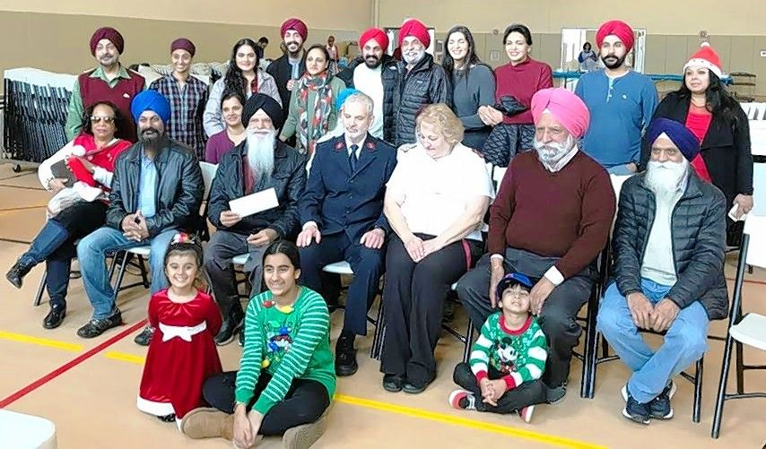 In addition to volunteering at the Salvation Army, Sikh Religious Society members donated food for the meal and for later use at the food pantry, as well as $1,101.
