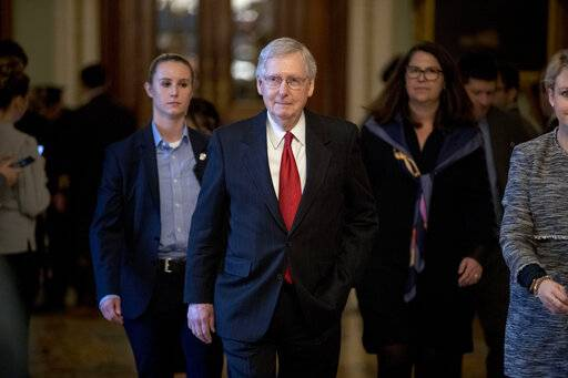 Senate Majority Leader Mitch McConnell of Ky. walks out of the Senate Chamber following two failed votes on ending the partial government shutdown on Capitol Hill in Washington, Thursday, Jan. 24, 2019.