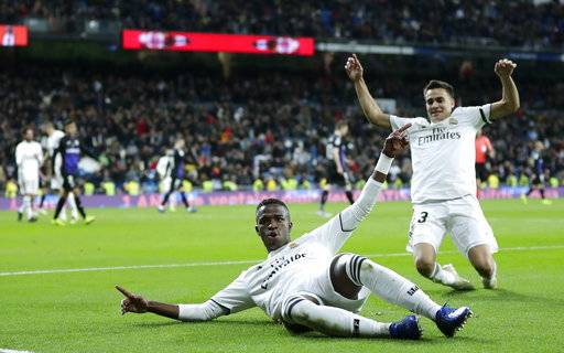 Real Madrid's Vinicius Jr, left, celebrates after scoring during a Spanish Copa del Rey soccer match between Real Madrid and Leganes at the Bernabeu stadium in Madrid, Spain, Wednesday, Jan. 9, 2019.