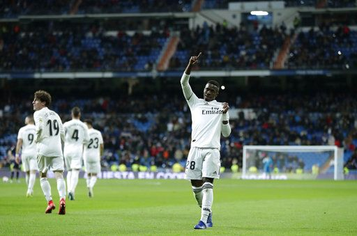 Real Madrid's Vinicius Jr celebrates after scoring during a Spanish Copa del Rey soccer match between Real Madrid and Leganes at the Bernabeu stadium in Madrid, Spain, Wednesday, Jan. 9, 2019.