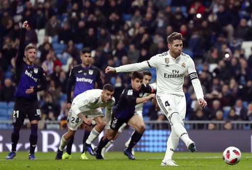 Real Madrid's Sergio Ramos, right, scores a penalty during a Spanish Copa del Rey soccer match between Real Madrid and Leganes at the Bernabeu stadium in Madrid, Spain, Wednesday, Jan. 9, 2019.