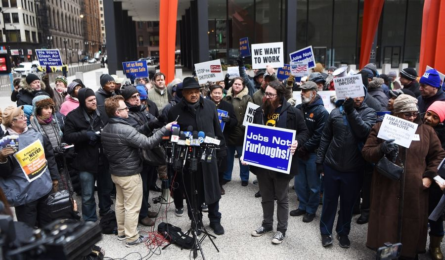 The Rev. Jesse Jackson speaks during a rally against the government shutdown Thursday at Federal Plaza in Chicago.