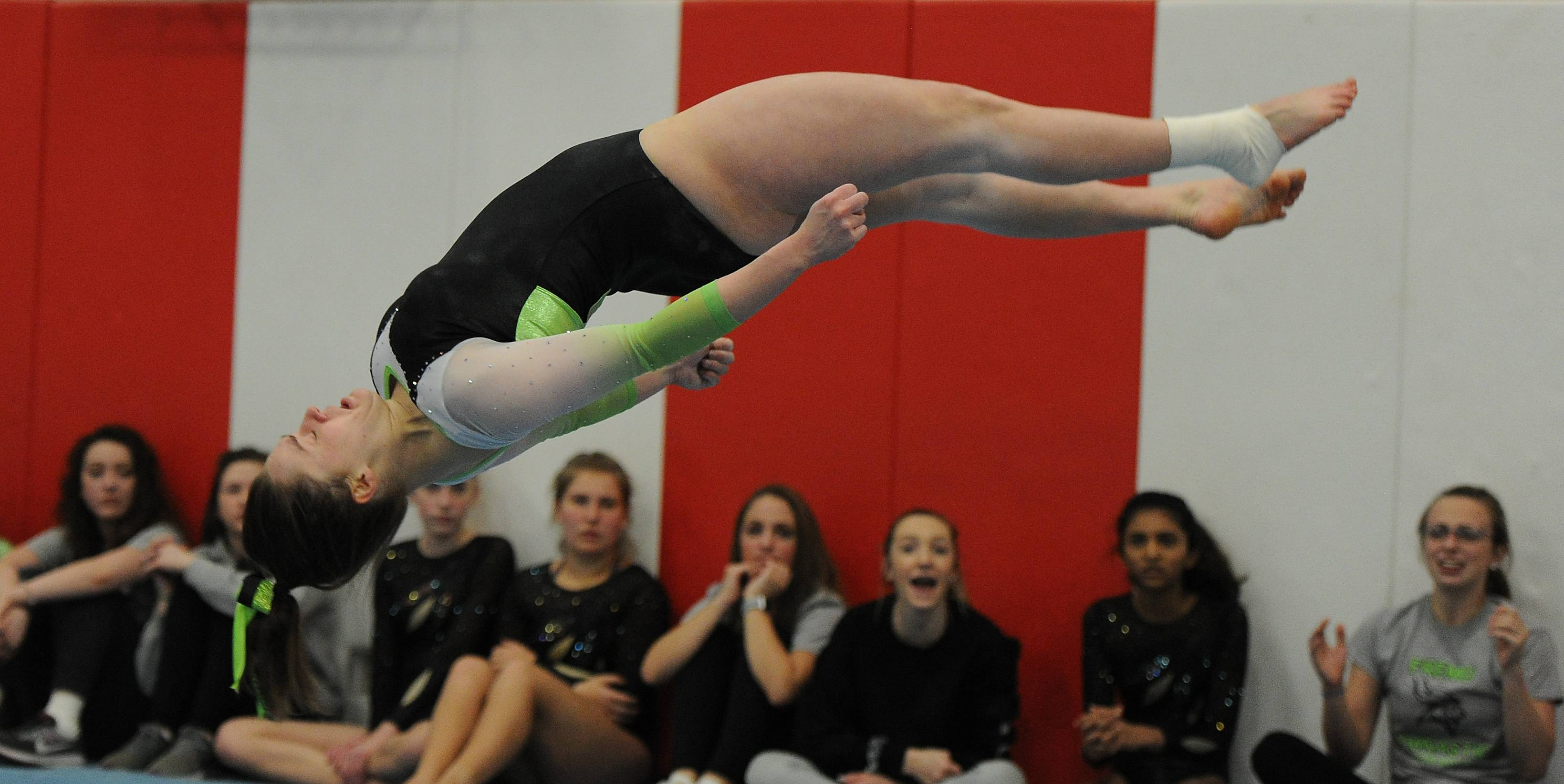 Fremd's Kate Watson does her head-over-heels routine on the floor exercise in the MSL varsity girls gymnastics triangular meet in Barrington on Thursday.
