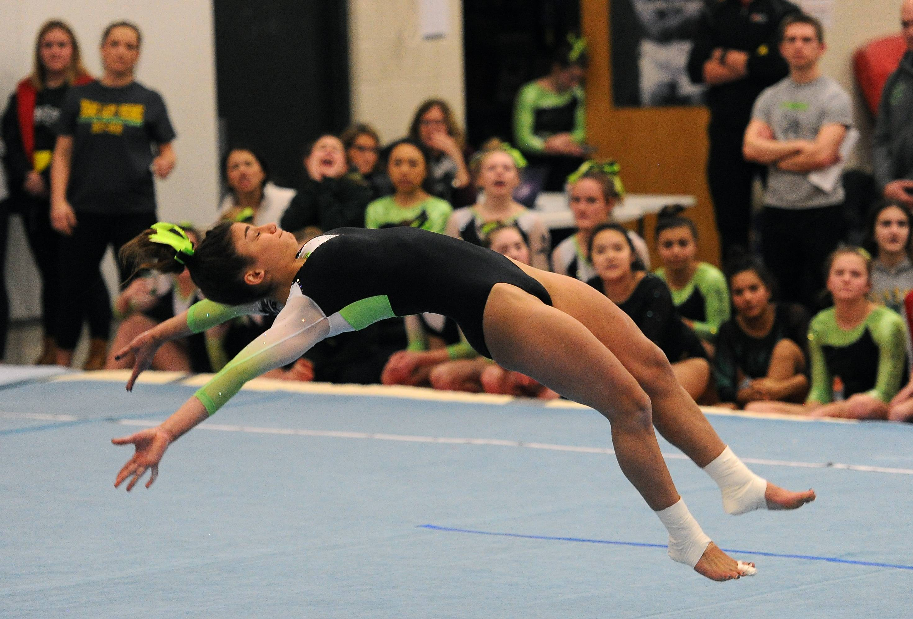 Fremd's Gianna Christodoulopoulos does her head-over-heels routine on the floor exercise in the MSL varsity girls gymnastics triangular meet in Barrington on Thursday.