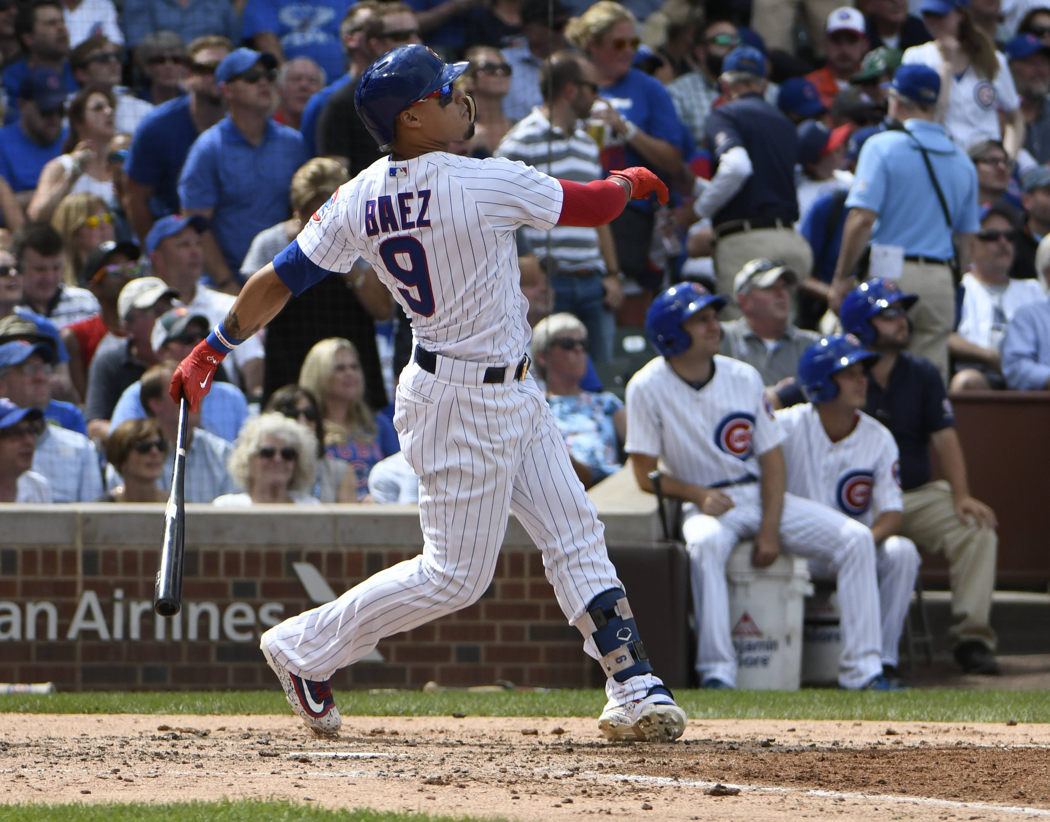 Cubs' Javier Baez watches his home run leave the yard during a 2017 game against the Reds. On Friday, the Cubs will exchange salary figures with seven of their players who are eligible for salary arbitration. The one to watch will be Baez, runner-up to Milwaukee's Christian Yelich for the National League Most Valuable Player award last year. Baez made $657,000 last season, and MLB Trade Rumors (mlbtradrumors.com) estimates he could get $7.1 million this year.