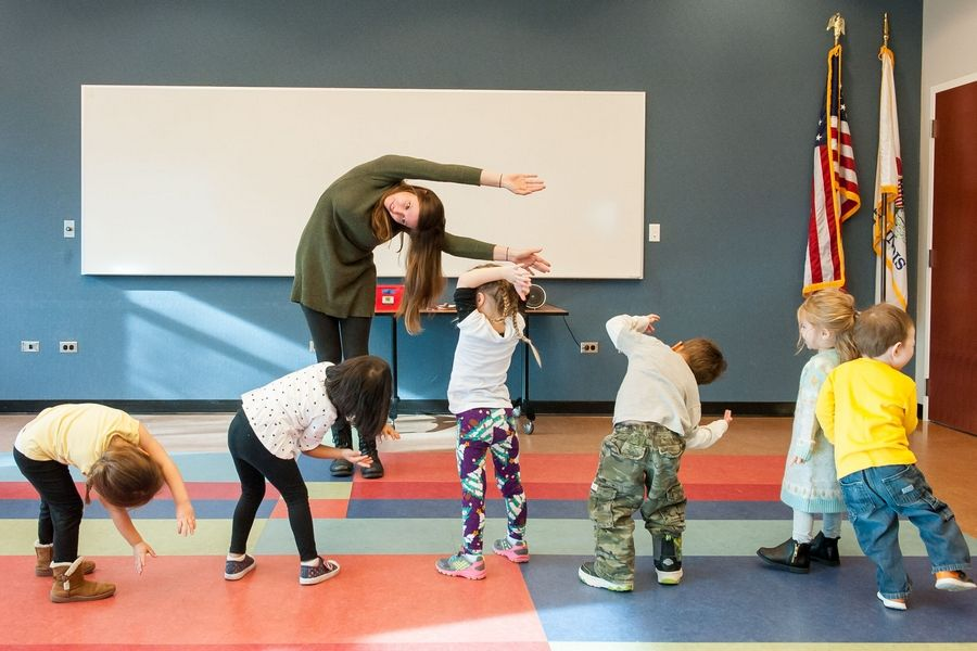 Preschool-age children have fun while exercising during a program at the Schaumburg Township Library, where a preschool open house will take place Jan. 31.