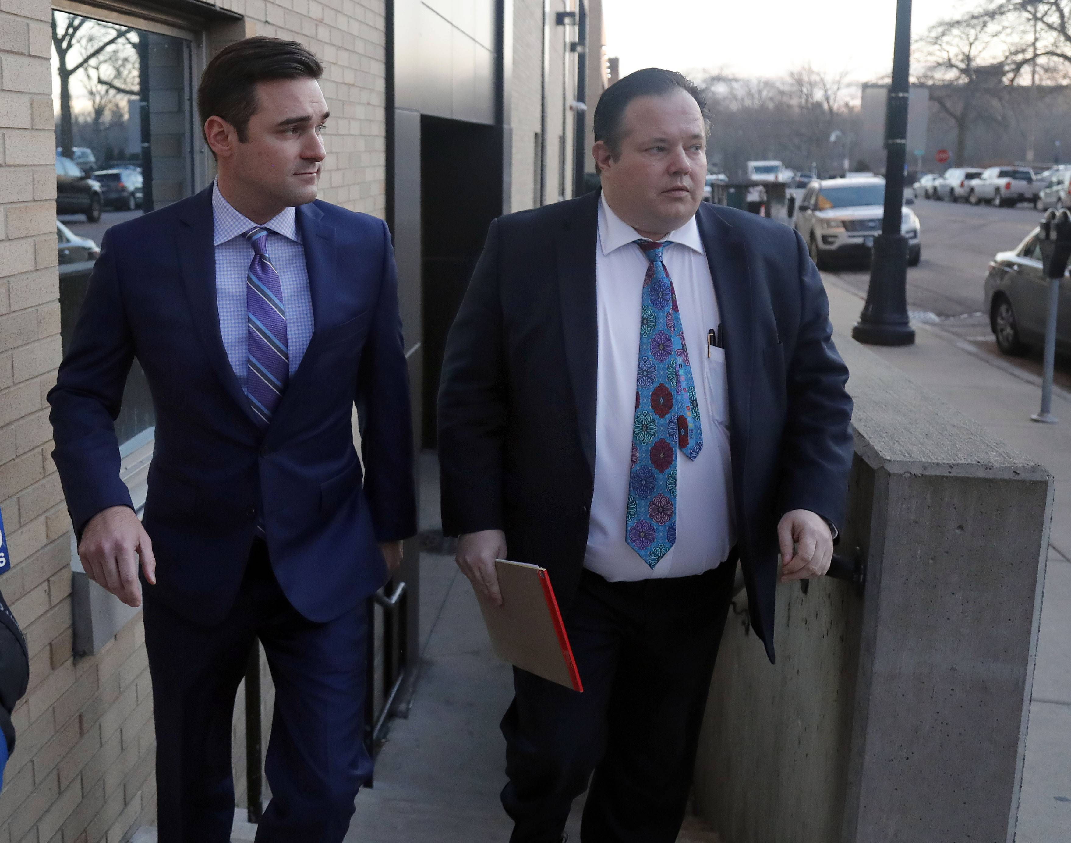 Former state Rep. Nick Sauer, left, leaves the Lake County jail with his lawyer after bonding out Thursday in Waukegan.