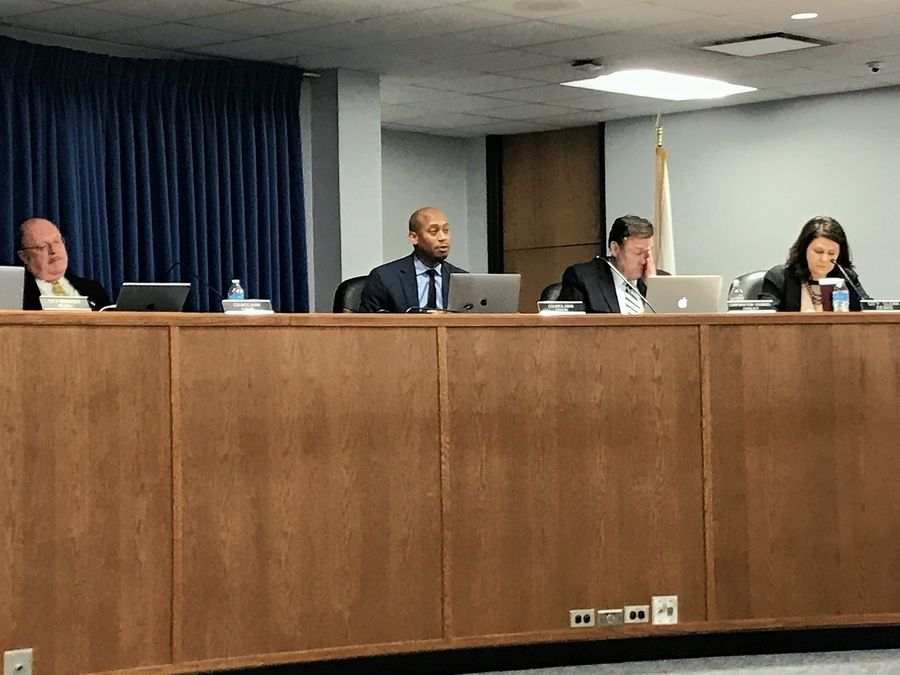 Elgin City Council member Corey Dixon, second from left, said at the meeting Wednesday that he doesn't want a police officer who fatally shot a resident in March to be allowed back on duty.