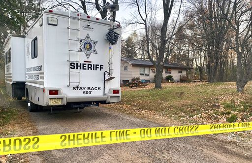 FILE - In this Oct. 23, 2018, file photo, a Barron County, Wis., sheriff's vehicle is parked outside the home where James Closs and Denise Closs were found fatally shot on Oct. 15. The Barron County Sheriff's Department said on its Facebook page that the missing teenager Jayme Closs has been found alive Thursday, Jan. 10, 2019, and that a suspect was taken into custody.
