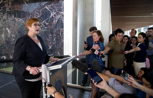 Australia's Foreign Minister Marise Payne, left, gestures as she answers a journalist's question in Bangkok, Thailand, Thursday, Jan. 10, 2019. Visiting Thailand on Thursday, Payne praised her hosts for their handling of the case of the young Saudi woman fleeing her family to seek asylum in Australia, but said she also reminded them of continuing concern about a Bahraini soccer player granted asylum in Australia who is in Thai detention.