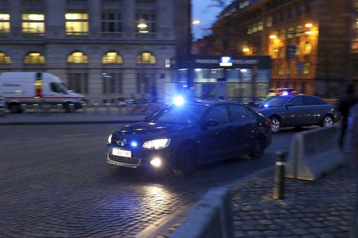 Police in unmarked cars arrive at the Justice Palace during the trial of Mehdi Nemmouche in Brussels, Thursday, Jan. 10, 2019. Mehdi Nemmouche is accused of shooting dead four people at a Jewish museum in Belgium in 2014.