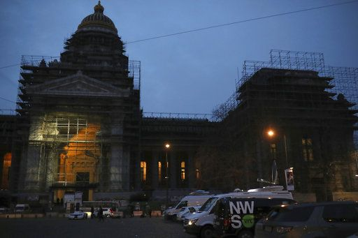 Media trucks are parked in front of the Justice Palace during the trial of Mehdi Nemmouche in Brussels, Thursday, Jan. 10, 2019. Mehdi Nemmouche is accused of shooting dead four people at a Jewish museum in Belgium in 2014.