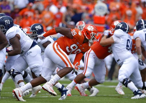FILE - In this Sept. 15, 2018, file photo, Clemson's Clelin Ferrell (99) rushes into the backfield during the first half of the team's NCAA college football game against Georgia Southern in Clemson, S.C. Clemson's defensive line came into the season with a ton of hype after Christian Wilkins, Austin Bryant and Ferrell all bypassed the chance to go to the NFL after 2017. Ferrell, an explosive pass rusher, has the most NFL upside.