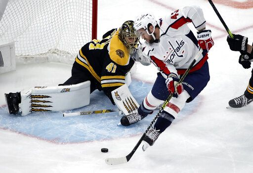 Washington Capitals right wing Tom Wilson (43) shoots but cannot score against Boston Bruins goaltender Jaroslav Halak (41) during the first period of an NHL hockey game Thursday, Jan. 10, 2019, in Boston.