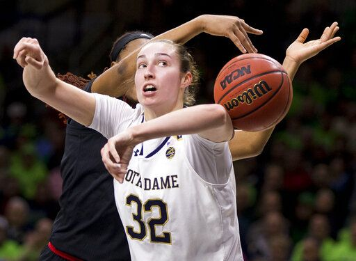 Notre Dame's Jessica Shepard (32) has the ball knocked away from behind by Louisville's Bionca Dunham during the first half of an NCAA college basketball game Thursday, Jan. 10, 2019, in South Bend, Ind.