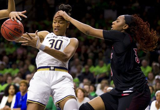 Notre Dame's Mikayla Vaughn (30) gets fouled while competing for a rebound with Louisville's Bionca Dunham during the first half of an NCAA college basketball game Thursday, Jan. 10, 2019, in South Bend, Ind.