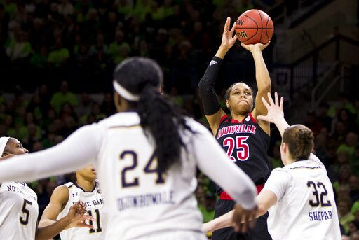 Louisville's Asia Durr (25) shoots a 3-pointer over Notre Dame's Jessica Shepard (32) during the first half of an NCAA college basketball game Thursday, Jan. 10, 2019, in South Bend, Ind.