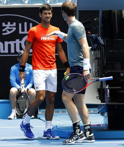 Britain's Andy Murray, right, gestures to Serbia's Novak Djokovic during a practice match on Margaret Court Arena ahead of the Australian Open tennis championships IN Melbourne, Australia, Thursday, Jan. 10, 2019.