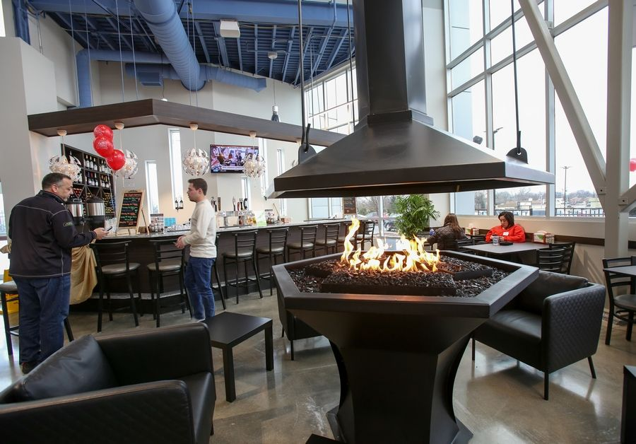 "The newly renovated Angelo Caputo's Fresh Markets store in Addison includes a bar, a restaurant and a fire pit area with seating. It's all part of the store's evolution to offer ""a food experience,"" CEO Robertino Presta said."