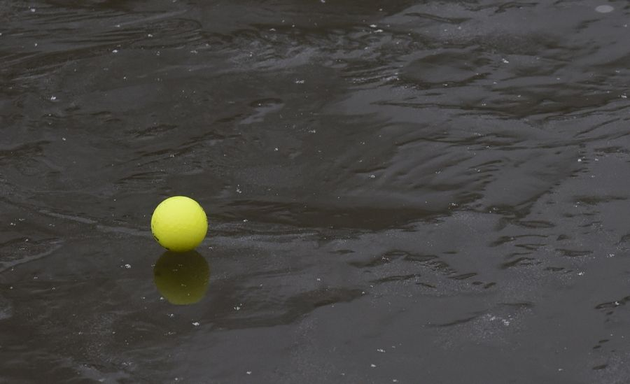 A ball rests on the icy water hazard during the Chilly Open at Arlington Lakes Golf Club in Arlington Heights Saturday.