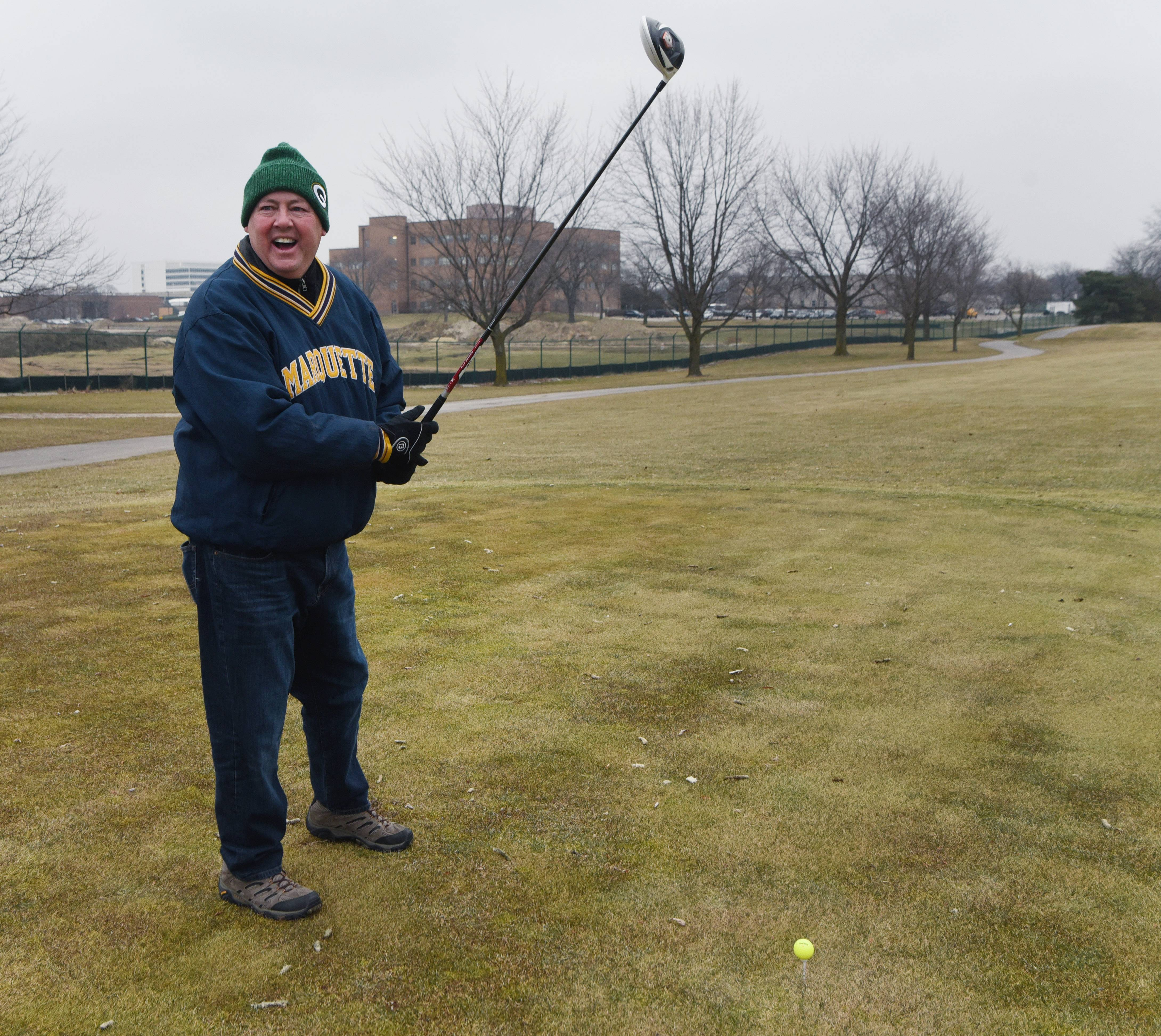 Bob Schultz of Arlington Heights gets ready to tee off during the Chilly Open at Arlington Lakes Golf Club in Arlington Heights Saturday.