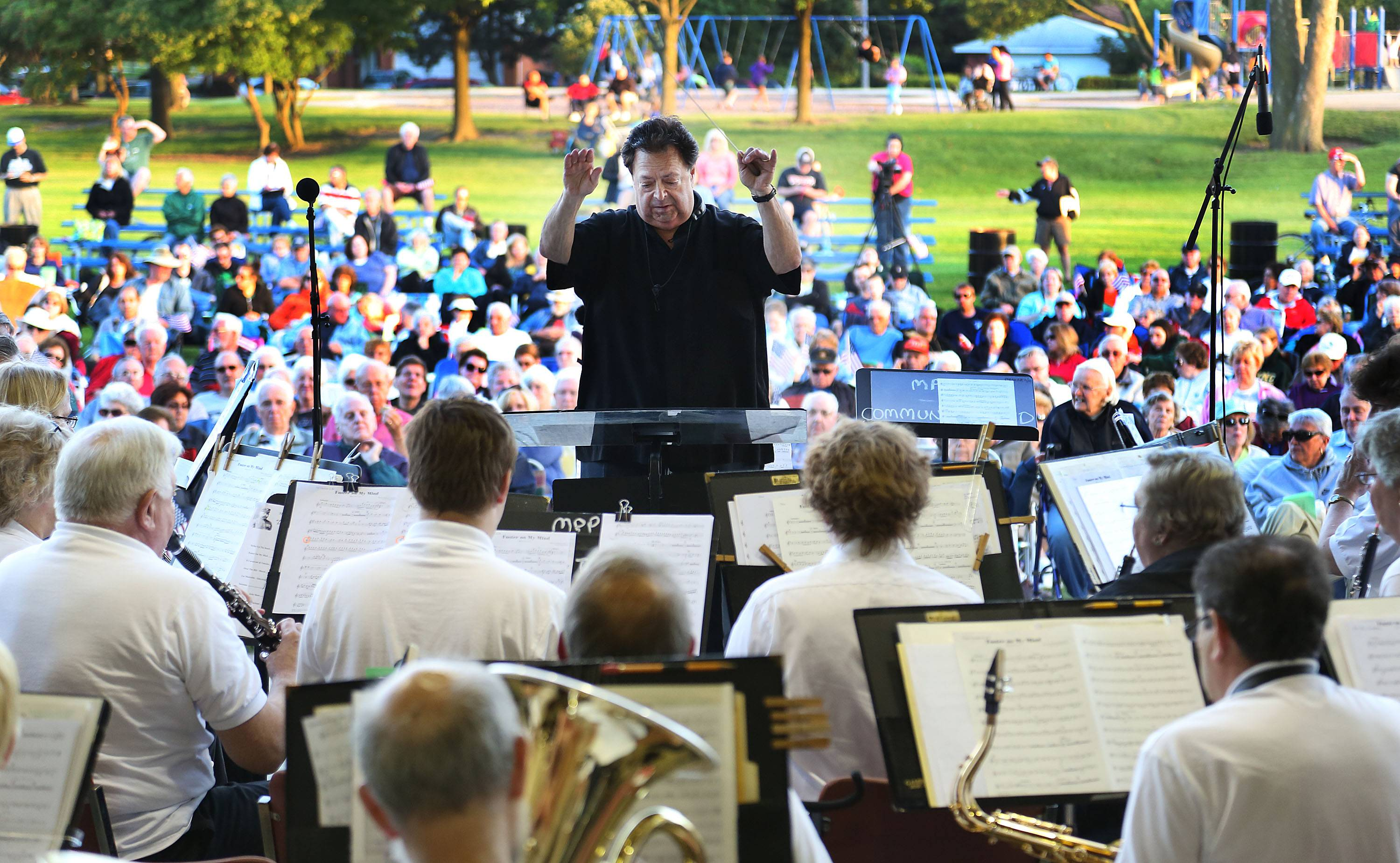 Suburban band conductor Ralph Wilder conducts a 2013 concert by the Mount Prospect Community Band.