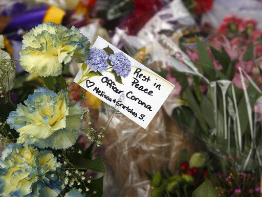 Flowers are seen on a memorial outside the Davis Police Department for slain Davis Police Officer Natalie Corona, Friday, Jan. 11, 2019, in Davis, Calif. Corona, 22, who had been on the job only a few weeks was shot and killed, Thursday, by a suspect who opened fire as she was investigating a three-car crash. The suspect was later found dead from a self-inflicted gunshot, following a standoff with officers.