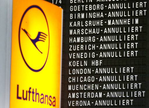 In this Wednesday, April 27, 2016, file photo, cancelled flights appear on a board when German ver.di union went on a warning strike at German airports in Frankfurt, Germany. A German labor union is calling on security staff at Frankfurt airport to go on strike on Tuesday, Jan. 15, 2019 in a dispute over pay.